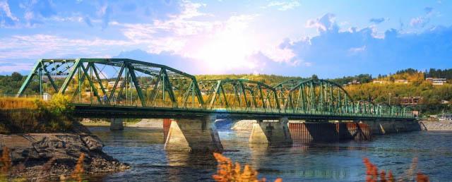Old Saguenay Bridge and River - Colorful Stock Photos