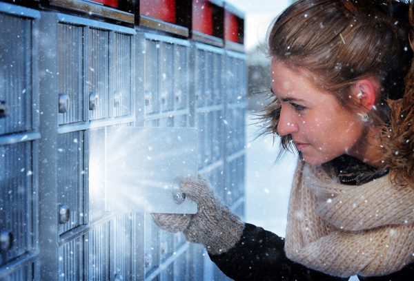 Pretty Woman Looking at Highlighted Mailbox in Winter - Colorful Stock Photos