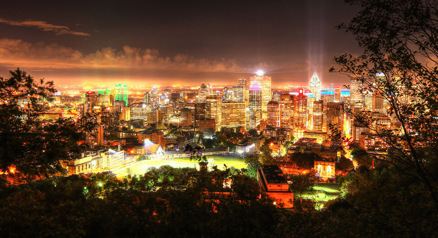 2020 Montreal City Sight at Night from the Mount Royal Hiking Trails - Colorful Stock Photos