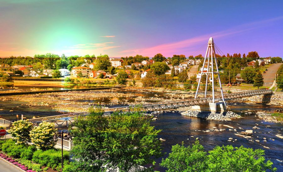 Colorful Pedestrian River Cross Footbridge in Saguenay