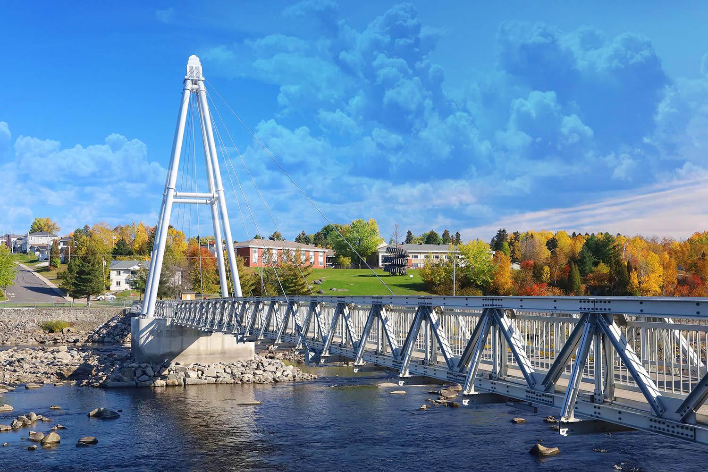 Modern Pedestrian River Cross Footbridge in Saguenay